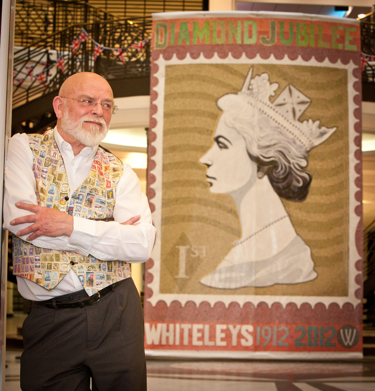 Artist Peter Mason, renowned for his portraits of A-list celebrities and politicians including Sir Cliff Richard, Simon Cowell and Margaret Thatcher, will use thousands of recycled stamps to re-create the iconic Machin Stamp portrait.   Peter, who references Pop Art and graphics in his practice, uses the stamps as pixels in a larger image. Scale is paramount in viewing and understanding Peter's work.  Peter chooses to use postage stamps and place them so that their usual significance becomes obscure, enabling the audience to see 'art' with new eyes. The artwork will take over 400 hours to complete and will be unveiled by Peter on 25 May 2012 in Whiteleys Shopping Centre atrium and will be open to the public until 28 August 2012.   Family-friendly craft workshops will be held to coincide with the exhibition on 3 June 2012. Children will be able to create their own version of the Queen's famous crown, as well as hearing a special reading of the classic children's book, The Queen's Knickers.   The Whiteleys Queen installation is unveiled on 25 May and will be available to see until 28August 2012. Please visit www.whiteleys.com for further details.     ————————————————————————— Charlotte Sluter       Sales & PR Executive Idea Generation Gallery —————————————————————————   ————————————————————————— Simon Annand: The Half. 24/02/12 – 08/04/12. More information.   Visit Idea Generation Gallery's online shop with Culturelabel.com   And proud to be supporting… SHOREDITCH FRINGE //www.shoreditchfringe.org   ——————————————————— T.   +44 (0)20 7749 6850 M:  +44 (0)78 149 75721 F.   +44 (0)20 7729 0513 Website: http://gallery.ideageneration.co.uk/ Twitter: @IG_Gallery Facebook: http://www.facebook.com/IdeaGenerationGallery   Idea Generation Gallery 11 Chance Street London E2 7JB